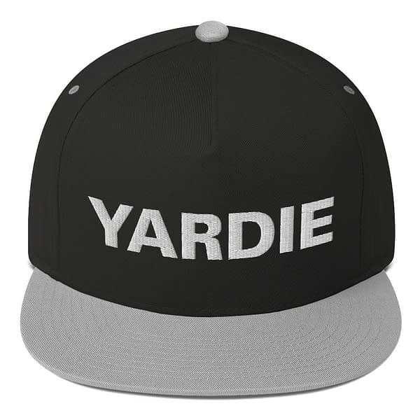 Yardie flat bill cap in black and grey. Jamaican Rasta Reggae Stylee. Quality Jamaican and Reggae merchandise available through Rastagearshop.com