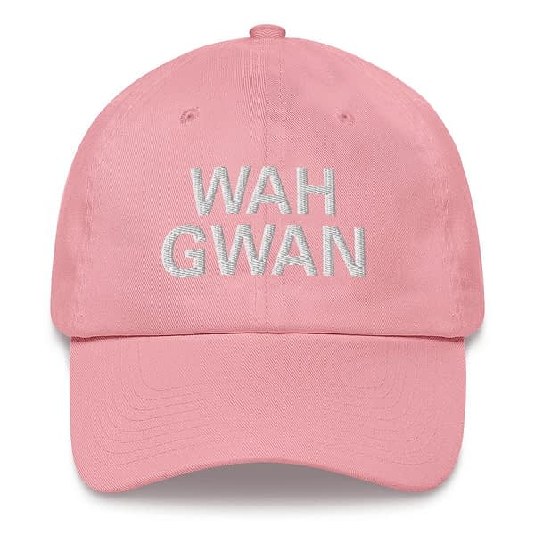 Wah Gwan Dad Hat in pink. Jamaican Patois embroidered Jamaican cap. Dad hats aren't just for dads. This one's got a low profile with an adjustable strap and curved visor. Rasta Gear Shop original merchandise and clothing.
