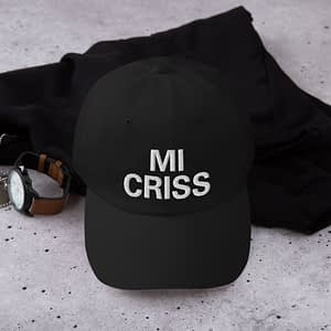 Mi Criss Dad Hat in black Jamaican Patois embroidered cap. Dad hats aren't just for dads. This one's got a low profile with an adjustable strap and curved visor. Rasta Gear Shop original Rastafarian, Reggae and Jamaican merchandise, hats, clothing and shoes.