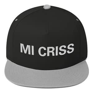 Mi Criss Rasta flat bill cap in grey and black. Jamaican patois embroidered letters. Classic Jamaican Cap. The high-profile fit and a green undervisor make this cap a classic with an added pop of color.Rastagearshop quality Jamaican merchandise.